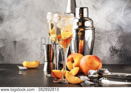 Bellini, Alcoholic Cocktail With Sparkling Wine, Sugar Syrup, Lemon Juice, Peach And Ice, Gray Table
