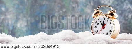 Christmas Or New Year Background With Golden Alarm Clock In Snowdrifts On Blue Background With Holid