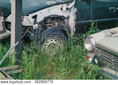 Detail Of Junkyard And Disposal Of Old Ruined Cars Ready For Recycling