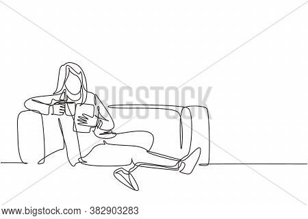 One Continuous Line Drawing Of Young Businesswoman Lying Down On The Sofa While Reading Book And Hol