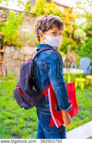 Caucasian Child With Face Mask Ready For Back To School. New Normality, Social Distance, Coronavirus