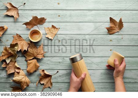 Zero Waste Eco Friendly Insulated Bamboo Flask With Bamboo Cups. Trendy Flat Lay With Hands Holding