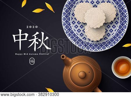 White Snow Mooncakes On Porcelain Plate, Teapot And Teacup. Chinese Translation Is Blessing And Mid