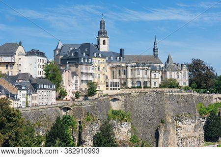 Luxembourg City, The Capital Of Grand Duchy Of Luxembourg, View At The Old Town With Medieval Fortre
