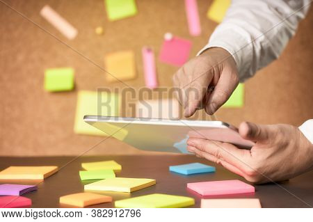 Businessman Using A Tablet Together With Post In A Brainstorming Session. Business Brainstorming Con