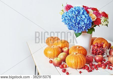 Autumn Harvest Pumpkin Background. Pumpkins, Apples And Flowers On Table. Thanksgiving Table. Copy S