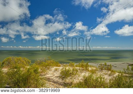 Sand Dunes In The Curonian Spit, A Narrow Peninsula Separating The Baltic Sea From The Curonian Lago