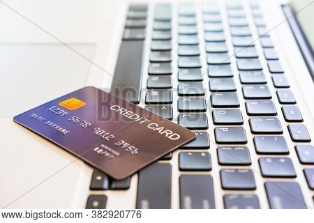 Selective Focus At Credit Card Letter Mock Up. Credit Card On Computer Laptop Keyboard With Copy Spa