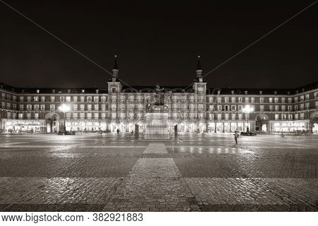 Plaza Mayor at night with historical building in Madrid, Spain.