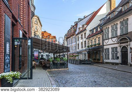 Riga, Latvia - July 28, 2019: Street Scene In The Old Town. Riga Is Famous For Its Highly Diverse Ar