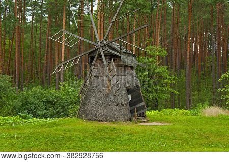 Riga, Latvia - July 29, 2019: Old Wooden Windmill In The Riga Open-air Ethnographic Museum.