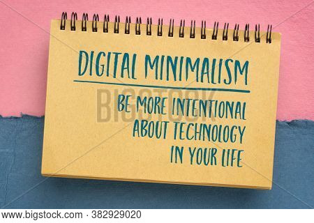 digital minimalism concept - be more intentional with technology in your life , handwriting in a sketchbook against handmade pastel rag paper