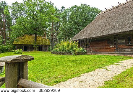 Old Latvian Wooden Houses Which Represent Architectural Style  Of The Country Regions.