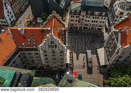 Looking Over The Riga  Old Town With Its Medieval Buildings And Daugava River