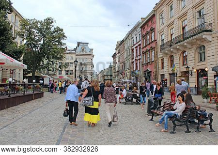 Lviv / Ukraine. 19 August 2013:central Street In Lviv. Tourists Walk Along Street Of Ukrainian City