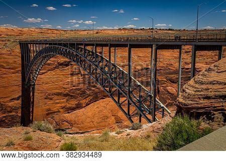 Page, Arizona, Usa - June 12, 2020: The Glen Canyon Dam Bridge Crosses The Colorado River Immediatel