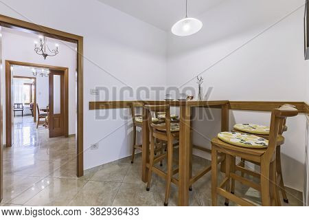 Interior Detail Of Corner Dining Table Against Open Living Room