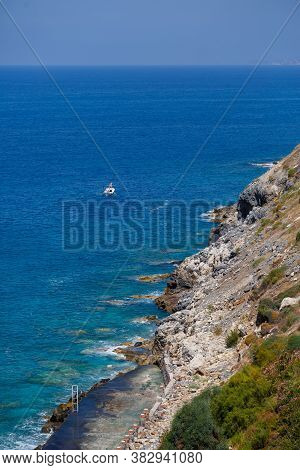 A View Of The Mediterranean Coast With Waves Of Azure Water. Summer Seascape. Seaside In Sunny Weath