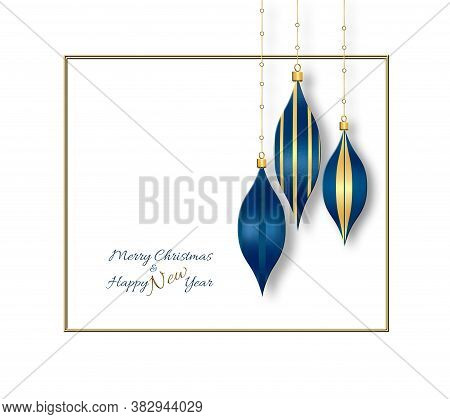 Luxury Blue Gold Christmas Baubles Hanging Against The White Background. Text Merry Christmas Happy