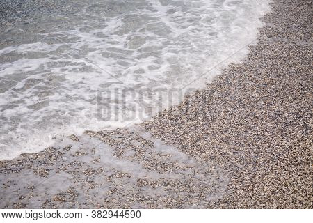 The Beach Of The Mediterranean Coast With Waves Of Azure Water. Summer Sea Breeze