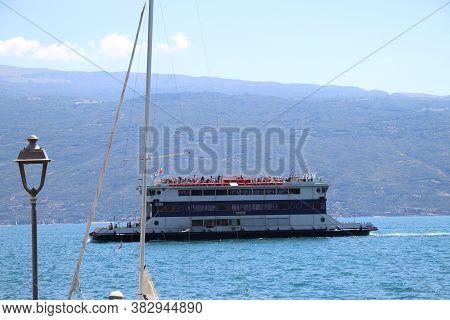 Lake Garda, Brescia,  Italy - 07/ 30/ 2020: An Old Paddle Steamer Boat On  Garda Lake