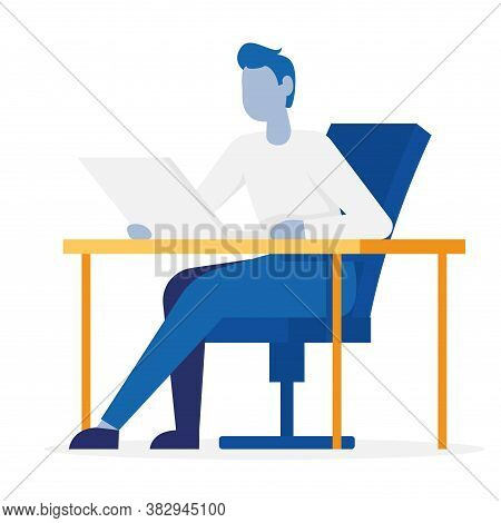 Man Sitting On Office Chair At A Computer Desk. He Is Looking At The Laptop And Typing On The Keyboa