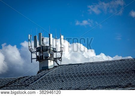 4g, 5g Telecommunications Transmitters On A Roof Of A Building. Cellular Base Station With Transmitt