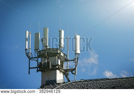 Telecommunication 4g, 5g Transmitters. Cellular Base Station With Transmitter Antennas On A Telecomm