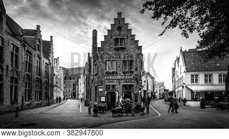 Brugge/belgium - Sept. 18 2018: Black And White Photo Of Historic Brick Houses At The Corner Of Mari