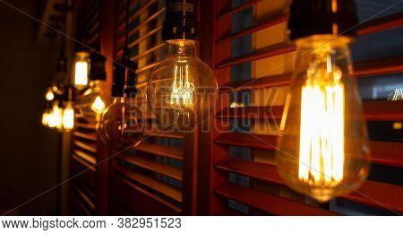 Golden Shining Antique Edison Style Bulbs In The Dark. Lighting Decor Concept. Vintage Light Bulb. B