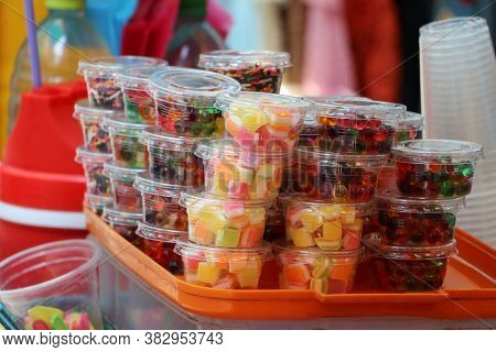 Stack Of Colorful Sweetmeat In The Plastic Cup For Sale.