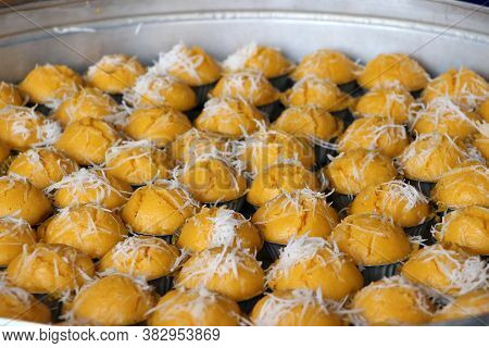 Steamed Toddy Palm Cake In Yellow Color With White Coconut, Thai Sweet Dessert.