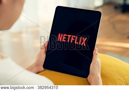 Bangkok, Thailand - August 30, 2020 : Women Use Netflix App On Ipad Pro Screen. Netflix Is An Intern
