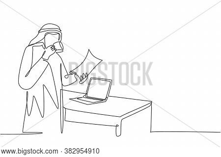 Single Continuous Line Drawing Of Young Muslim Businessman Reading Business Annual Report. Saudi Ara