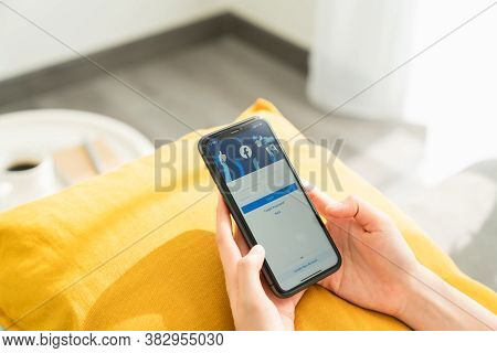 Bangkok, Thailand - August 30, 2020 : Woman Hand Is Pressing The Facebook Screen On Apple Iphone 11,