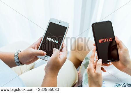 Bangkok, Thailand - August 30, 2020 : Women Holding Smartphone With Show Hbo And Netflix App. Stream