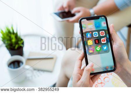 Bangkok, Thailand - August 30, 2020 : Hand Using Iphone Of Show Display App Social Media Screen. The