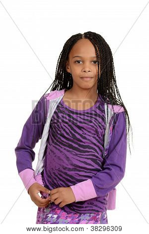 Young black child wearing purple outfit