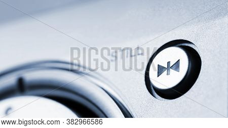 A Pause Button With A Blurry Label Next To It. Selective Focus.