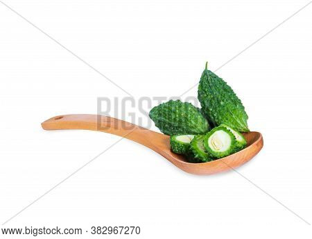 Bitter Gourd Pile With Piece In Wooden Spoon On White Background. Vegetable Herb Nourish The Health