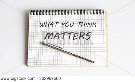 The Question What Do You Think Text On Notepad With Pen