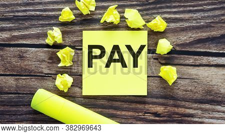 Case Study . Notes About Pay , Concept On Yellow Stickers On Wooden Background