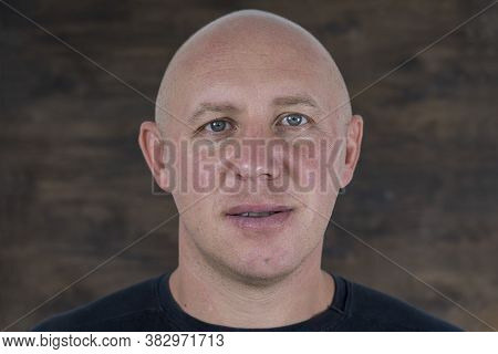 Closeup Shoot Of Middle-aged Caucasian Bald Man Looking Straight At Camera. People And Lifestyle Con