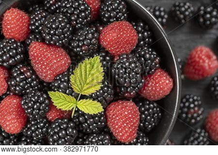 Background From Fresh Organic Blackberries And Raspberries, Close Up. Top View Blackberry And Raspbe