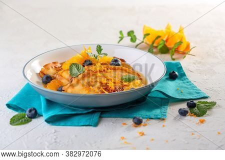 Thin French Crepes With Orange Sauce.