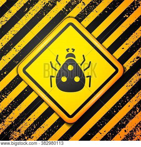 Black Ladybug Icon Isolated On Yellow Background. Warning Sign. Vector