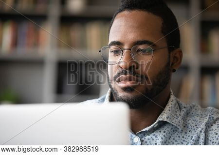 Close Up Serious African American Man Looking At Computer Screen
