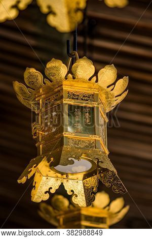 Koya, Wakayama Prefecture / Japan - April 29, 2018: Golden Lantern At An Ancient Buddhist Temple At