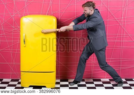 Man Formal Elegant Suit Beat With Wooden Bat Retro Vintage Yellow Refrigerator. Bachelor Hungry Want