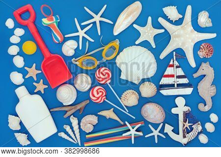 Summer holiday beach collection with seashells, beach toys, rock candy, symbols, beach wear and suntan protection lotion. Summer themed concept on blue background.